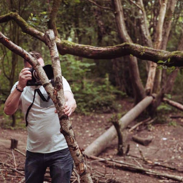 jon at er photography taking photos from a bush