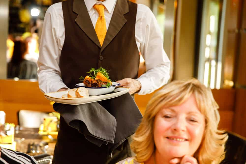 a waiter with food at the pavilion bury