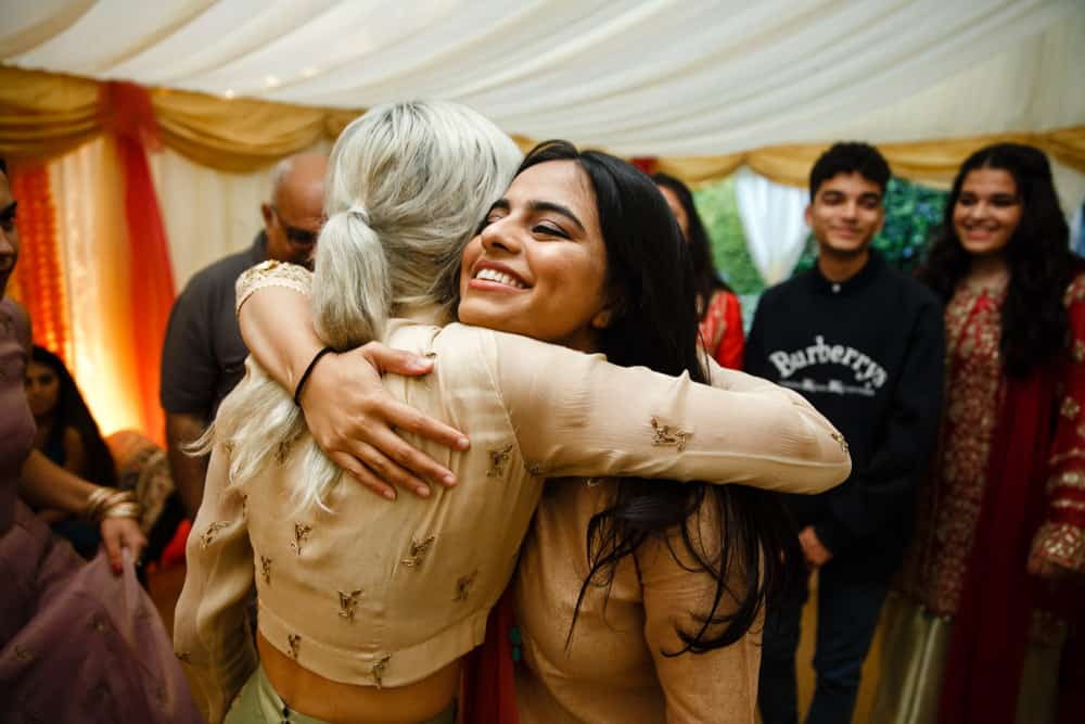 hug at a mehndi celebration