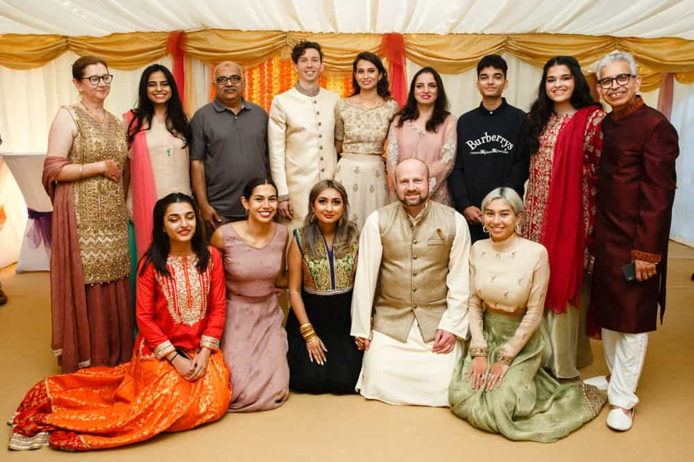 family group photo at mehndi celebration